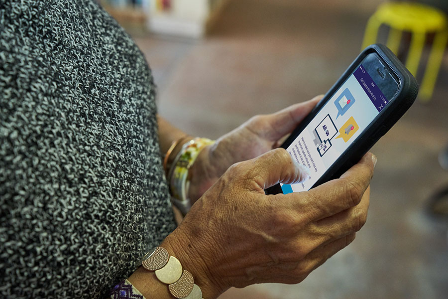 A participant uses the All of Us Research Program mobile app on a smartphone.